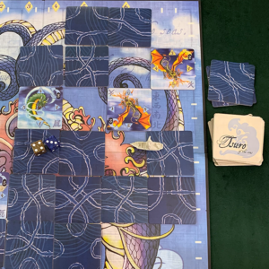 Tsuro of the seas game board with discarded wake tiles