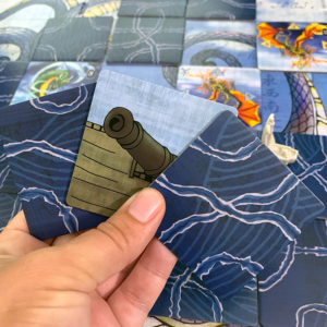 Tsuro of the seas with cannon tile in hand