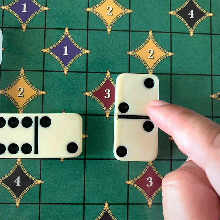 placing a domino on a 3 point score square