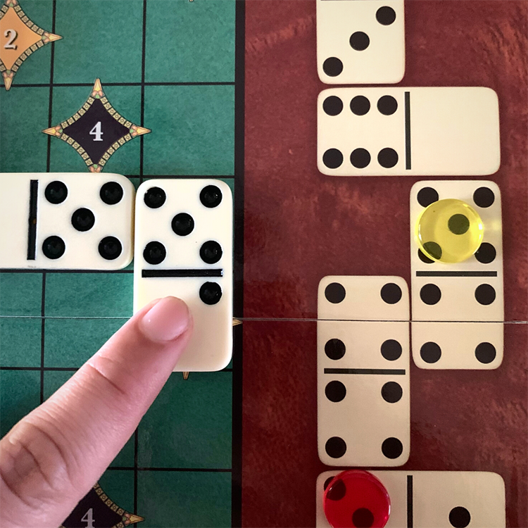 placing a 5 value domino with the yellow player on the 5 value score track spot
