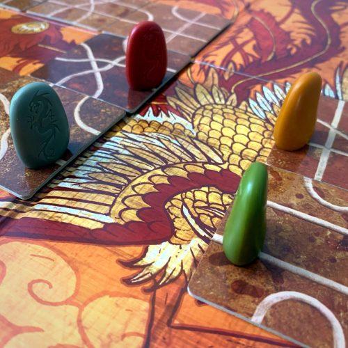 4 Tsuro tokens about to meet